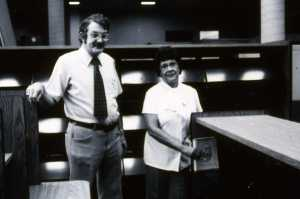In September 1978, the new LRC opened to the public.  In this picture, President Frederick Schlimm watches Johnnie Mae Berry place the first library book on the shelf.
