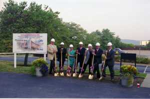 "2002 – In the summer of 2002, Cincinnati State held a groundbreaking ceremony for the new Advanced Technology and Learning Center (ATLC). Slated to open in 2004, the $55 million center would add 12 kitchens for the culinary arts program, a 200-seat auditorium, computer labs, a cafeteria, lounges, and a bookstore. Administrators hoped the building would help to create a ""real college"" feel for the commuter campus."