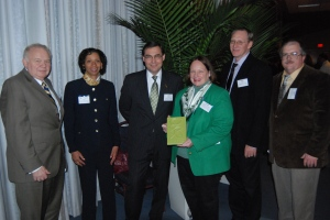 2011 – Vice President Monica Posey and others pose with the Green Business Award. A runner-up in 2010, Cincinnati State earned the award in 2011 as a result of the college's efforts to promote green classes community programs.