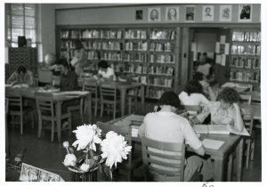 ca 1976 – The original campus library was on the second floor of the main building, where the Writing Center lab is now located. By the mid-1970s, increased enrollment necessitated a larger library, and construction began to convert the Courter Tech auditorium into the Library Resources Center.