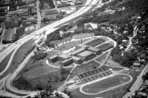 ca. 1969 - Aerial view of campus including Trechter Memorial Stadium