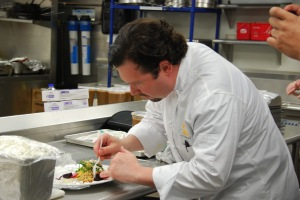 Unidentified man prepares meal at the Summit restaurant (part of the Midwest Culinary Institute) - 2012