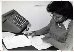 Michele Geers (Left), Accounting faculty member, helps a student with some classwork (ca. 1980s)