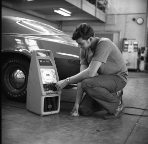 Unidentified male student works on car in Cincinnati State workshop (date unknown)