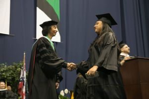 Dr. Posey hands out diplomas at Cincinnati State's Commencement Exercise held on May 8, 2016 at Xavier University's Cintas Center.